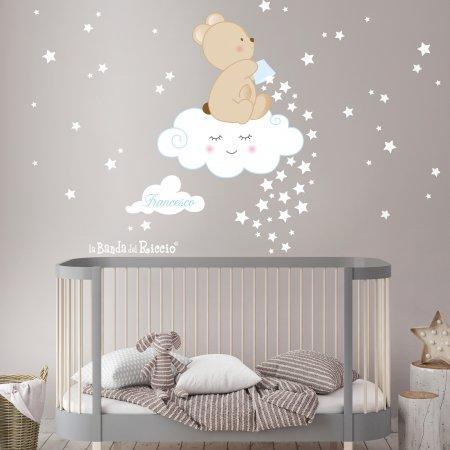 Adesivo Murale Stelle cadenti: un orsetto lancia tante stelline da una nuvola